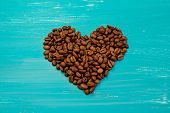 heart Of Coffee Beans On A Blue Wooden Background