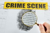 foto of crime scene  - Person Hand With Magnifying Glass Over Document Revealing Binary Code And Crime Scene Tape On It - JPG
