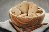 Heart Cookies For Valentines Day In Olive Bowl On Wood Table