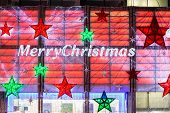 London, England - Merry Christmas Sign On Boots Shop, Oxford Street, decorated for Christmas 2015