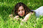 Woman Having Rest On Meadow