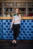 Woman Posing Near Bar