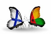 Two Butterflies With Flags On Wings As Symbol Of Relations Finland And  Guinea Bissau