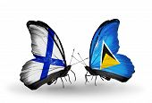 Two Butterflies With Flags On Wings As Symbol Of Relations Finland And Saint Lucia