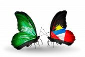 Two Butterflies With Flags On Wings As Symbol Of Relations Saudi Arabia And Antigua And Barbuda