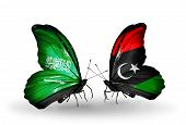 foto of libya  - Two butterflies with flags on wings as symbol of relations Saudi Arabia and Libya - JPG