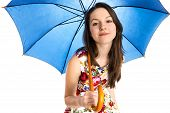 Young attractive woman under umbrella