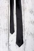 Trendy tie on color wooden background