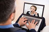 foto of video chat  - Businessman Video Chatting With Businesswoman On Laptop - JPG