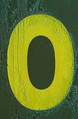 Yellow Letter O Covered With Frost
