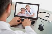 Doctor Video Chatting With Nurse And Patient