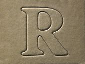 die cut alphabet r on the brown card board