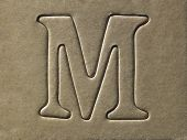 die cut alphabet m on the brown card board