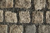 Cobbled pavement made of granite cubes. Background texture.