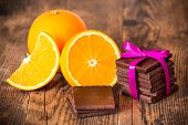 Chocolate brown wooden table next to orange.