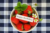 Happy Birthday card with bowl of fresh strawberries
