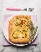 focaccia with sliced potatoes and rosemary
