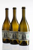 Empty Bottles Of Wine From The Label Of Dollar Bill