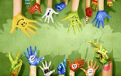 Human hands in colorful paint showing symbols