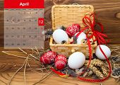 Easter Composition With Eggs  In A Basket With A Calendar For April 2015.