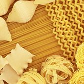 Italian spaghetti pasta dried food selection forming an abstract background.