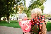 Постер, плакат: Beautiful Mother And Baby outdoors