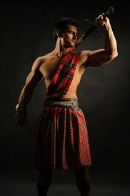 pic of sword  - the highlander is ready for battle with a sword - JPG