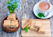 stock photo of eat me  - homemade sesame cookies with cup of tea - JPG