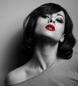 picture of red-necked  - Sexy model with short hair style and red lips posing on dark background - JPG