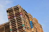 stock photo of wooden pallet  - Stacked wooden pallets at a pallet storage - JPG