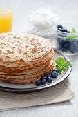 image of crepes  - close up view of nice yummy crepes with berry on table - JPG