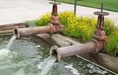 image of bend  - Two drainage pipes with flowing water in Bend Oregon - JPG