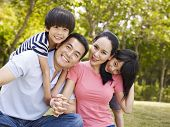 image of japan girl  - asian family with two children taking a family photo outdoors in a city park - JPG