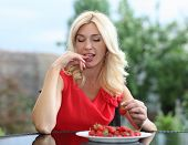picture of strawberry blonde  - Blonde beautiful girl laughing eating and playing with fresh strawberry - JPG