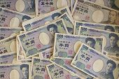 image of yen  - A large pile of Japanese yen notes - JPG