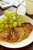 Oatmeal pancakes and grapes
