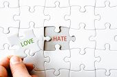 foto of hate  - Hand with missing jigsaw puzzle piece - JPG
