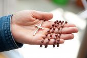 stock photo of rosary  - Woman holding rosary in her hand - JPG