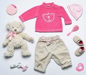 foto of girl toy  - top view fashion trendy look of baby girl clothes and toy stuff baby fashion concept - JPG