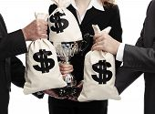 foto of money prize  - workteam sharing trophy and money bags isolated on a white background - JPG