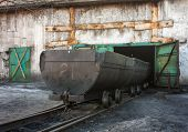 stock photo of railroad yard  - Empty trolley on mine yard - JPG
