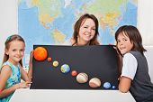 stock photo of earth mars jupiter saturn uranus  - Kids with their science teacher showing their home project  - JPG
