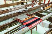 stock photo of silk worm  - Ancient Silk weaving machines seen in rural Thailand - JPG