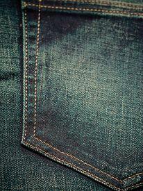 picture of denim jeans  - closeup detail of blue denim jeans trouses pocket texture background - JPG