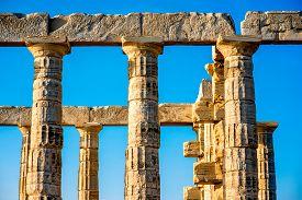 stock photo of poseidon  - Architectural fragments of Poseidon temple in Sounion - JPG