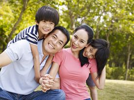 picture of japan girl  - asian family with two children taking a family photo outdoors in a city park - JPG