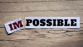 stock photo of transformation  - Word impossible transformed into possible - JPG