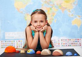stock photo of uranus  - Little girl in elementary science class with her home project  - JPG