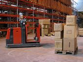 A Truck Lifting Pallet At A Warehouse