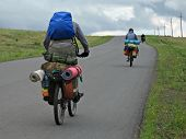 Three Cyclists Go To Road.